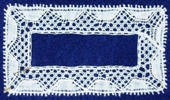Flanders Lace, rectangle with gimp thread outlining solid scallops into honecomb ground.